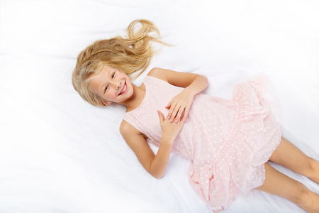happy beautiful girl in pale pink dress Stock Photo