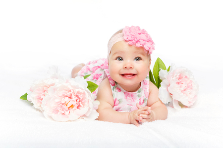 happy beautiful baby girl with flower on head
