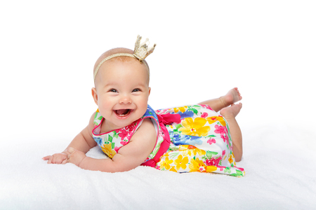 happy beautiful baby girl with crown on head Stock Photo
