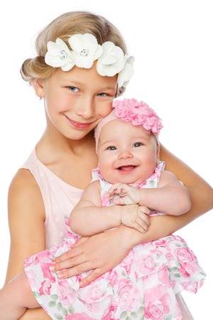 happy beautiful girl with baby baby sister Stock Photo