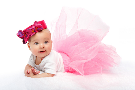 happy beautiful baby girl with pink hat on head Stock Photo