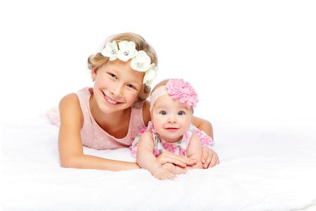 happy beautiful girl with baby baby sister Standard-Bild