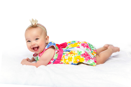 happy beautiful baby girl with crown on head Standard-Bild