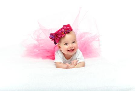 happy beautiful baby girl with pink hat on head Standard-Bild