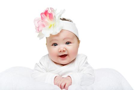 happy beautiful baby girl with flower headband