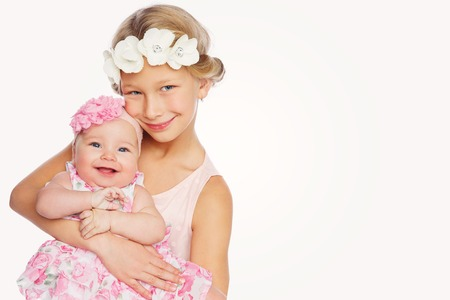 happy beautiful girl with baby baby sister Standard-Bild