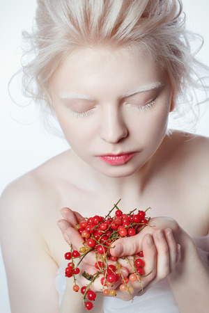 beautiful albino young woman with red berries Stock Photo