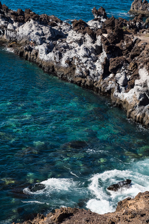 beautiful view on blue ocean water and rocky coast line. outdoor shot on tenerife island. copy space. Stock Photo