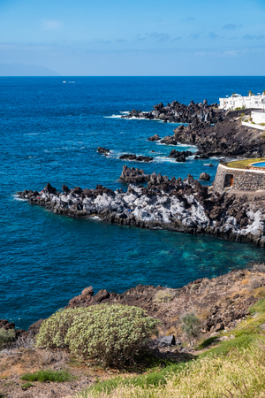 beautiful view on ocean water and santiago del teide town. outdoor shot on tenerife island. copy space.