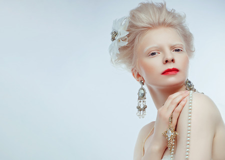 beautiful albino girl with red lips on white background Stock Photo