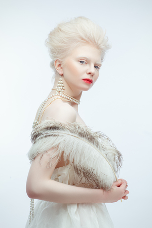 beautiful albino girl with red lips on white background Standard-Bild