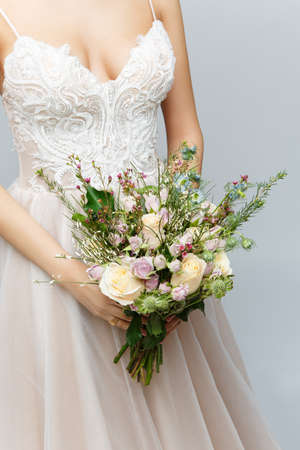beautiful bride holding bridal bouquet