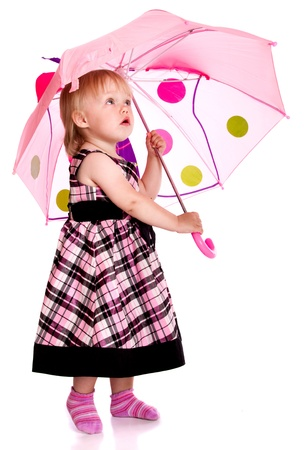 innocent girl: The little girl with an umbrella Stock Photo