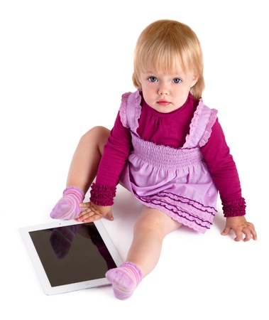 The little girl with iPad Stock Photo - 10675432