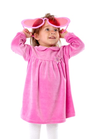 A little girl with big pink glasses. Isolated on a white background photo