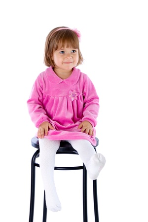 high chair: The little girl sits on a high chair. Isolated on a white background Stock Photo