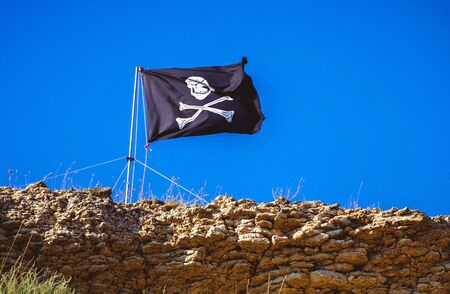 grand strand: Flag of a Pirate skull and crossbones - Crimea, Russia Stock Photo