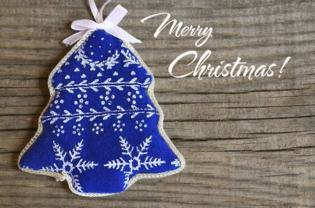 textille: Christmas decoration on old wooden background.Merry Christmas, Winter Holidays card.Soft focus, copy space