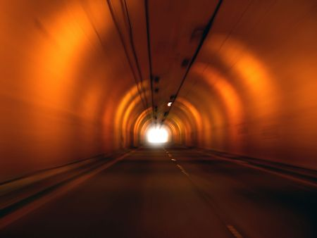 Tunnel with Light at End Stock Photo