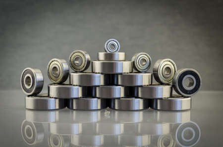 Metal bearing. Spare parts for machinery. Steel bearing with balls? Composition with bearings. Mechanisms, transport.