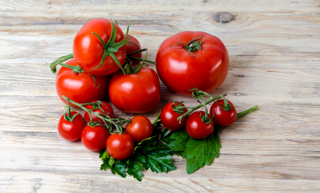 cooking oil: Composition from a tomato on a wooden background. Stock Photo