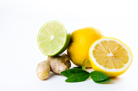 Composition of lemon lime and mint leaves on a white background.