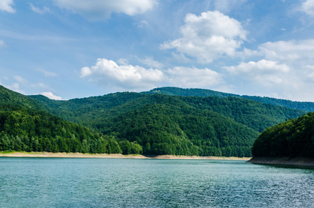 Beautiful landscape. Lake in the background of beautiful green mountains Stock Photo