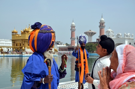 sikhism: The colorful guards in the complex Harmandir Sahib;  Golden Temple, Amritsar, India