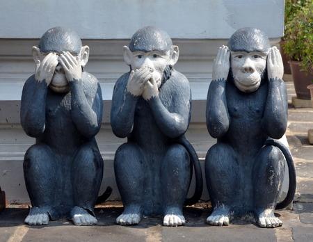 nothing: I see nothing, hear nothing, say nothing;  Three monkeys, sculpture in Bangkok, Thailand