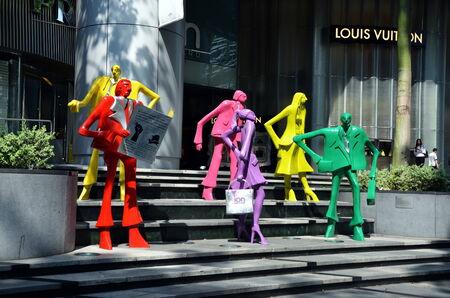 vuitton: Mannequins at boutique Louis Vuitton in Singapore  Editorial