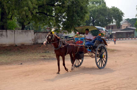 cartage: A man rides a horse harnessed to a cart in Bagan, Myanmar