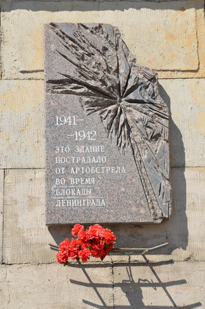 memorial plaque:  The plaque on the building in St  Petersburg;  1941-1942 This building was damaged by shelling during the siege of Leningrad   Editorial