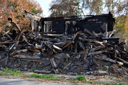 After the fire;  Burnt wooden house