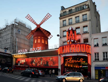 moulin: Moulin Rouge in the early evening. Moulin Rouge is a famous cabaret built in 1889, locating in the Paris red-light district of Pigalle