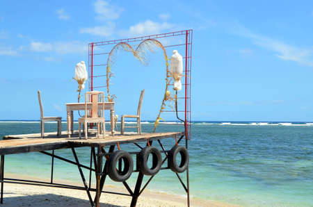 Table for lovers over the ocean. The island of Gili Trawangan, Indonesia photo