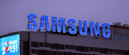 samsung: Samsung logo at night. Samsung Group is a South Korean multinational conglomerate company headquartered in Samsung Town, Seoul Editorial