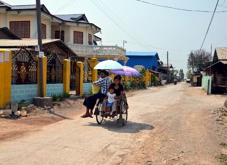 trishaw: Burmese family rides on a trishaw. Nuang Shwe, Myanmar Editorial
