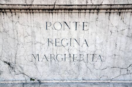 regina: Stone plaque on Ponte Regina Margherita Queen Margherita Bridge in Rome Italy. The bridge was designed by architect Angelo Vescovali and built between 1886 and 1891