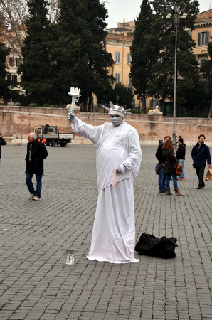 live work city: Statue Of Liberty. Live sculpture on a square in Rome, Italy