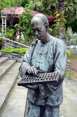 merchant: Merchant  with  abacus. Urban sculpture in Singapore