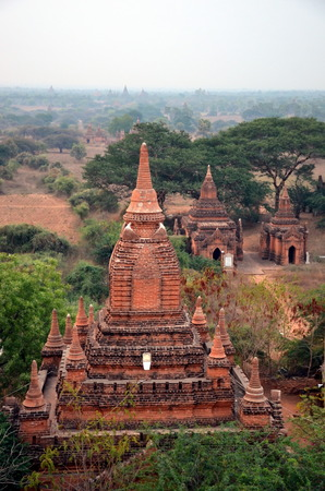 tiers: Dawn over Bagan, Myanmar. View of the ancient Buddhist stupas Stock Photo