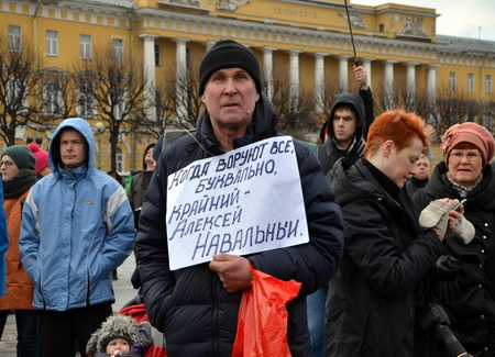 boris: Action in memory of Boris Nemtsov in St. Petersburg on March 1st 2015. A man with a poster in support of opposition politician Alexei Navalny Editorial