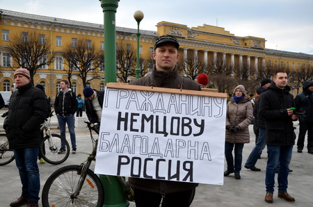 boris: Procession in memory of Boris Nemtsov in St. Petersburg on March 1st 2015. A man with a poster: Russia is grateful to Boris Nemtsov
