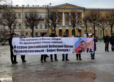 boris: Action  in memory of Boris Nemtsov in St. Petersburg on March 1st 2015. People hold a banner with verses dedicated to Boris Nemtsov Editorial