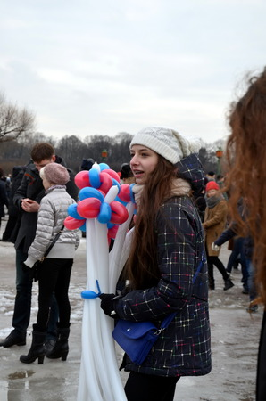 Action in memory of Boris Nemtsov in St. Petersburg on March 1st 2015. Girl with balloons of colors of the Russian State flag