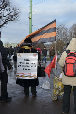 hands off: Action  in memory of Boris Nemtsov in St. Petersburg on March 1st 2015. Provocateurs with the poster: USA! Hands Off Russia! Editorial