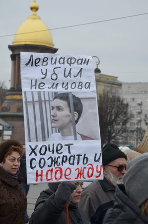 devour: Procession in memory of B. Nemtsov in St. Petersburg on March 1st 2015. People hold a banner : Leviathan killed Nemtsov and wants to devour Nadezhda Savchenko