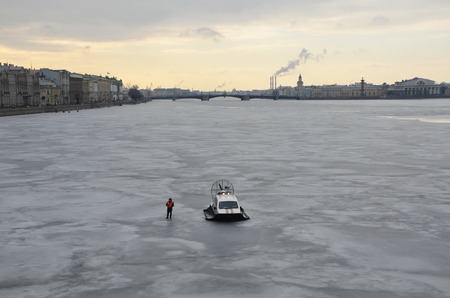 boris: Employee of the Ministry of Emergency Situations stands next to hydroplane on the Neva river. Action in memory of Boris Nemtsov on March 1, 2015