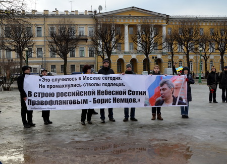 boris: Procession in memory of Boris Nemtsov in St. Petersburg on March 1st 2015. People hold a banner with verses dedicated to Boris Nemtsov Editorial
