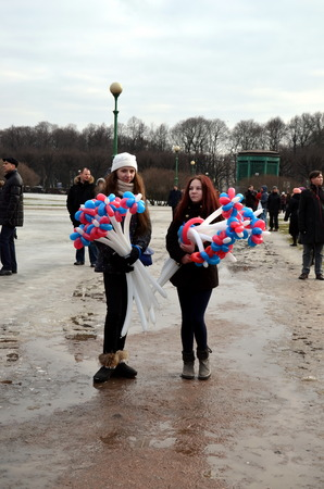 boris: Procession in memory of Boris Nemtsov in St. Petersburg on March 1st 2015. Two girls with balloons of colors of the Russian State flag Editorial
